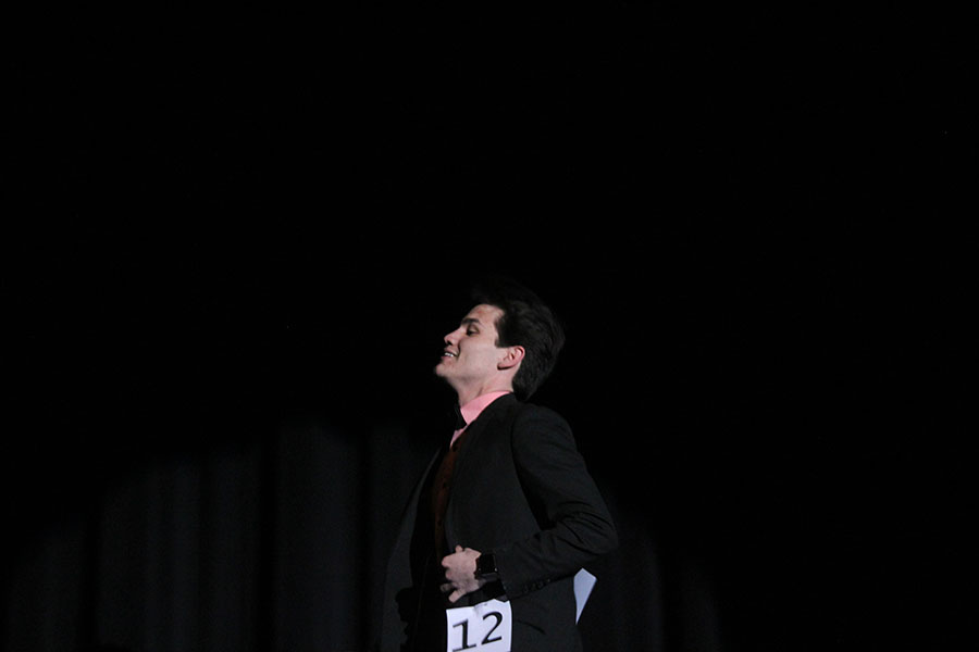 Senior Jimmy Piraino walks across the stage in his formal wear.
