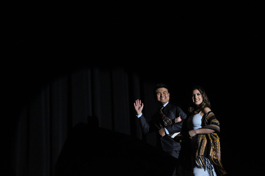 Senior James Thang walks with his escort senior Micaela Galvez in the formal wear competition.