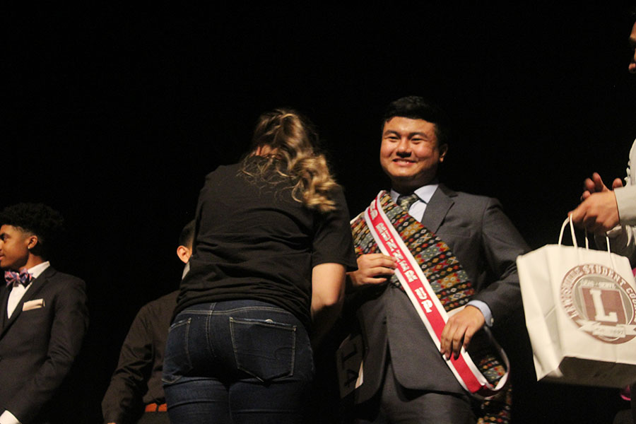 After receiving his sash, senior James Thang wins third place in Mr. Farmer.