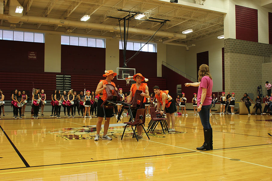 English 3 teacher Madelyn Johnson instructs the boneheads where to put the chairs as they get ready for a game of musical chairs.