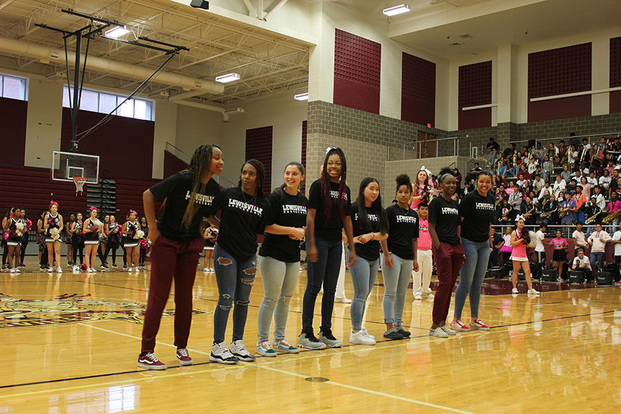 The girls basketball team is introduced.