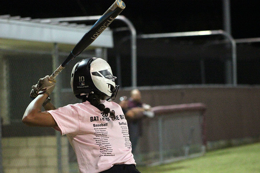 Senior+team+captain+Sierra+Nixon+steps+up+to+the+plate+to+bat+during+the+Battle+of+the+Bats+game+on+Wednesday%2C+Oct.+23.