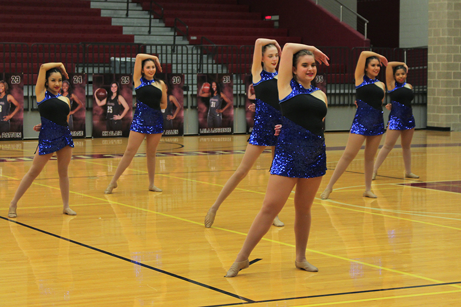 Sophomore McKailyn Foley leads the end pose of the JV Farmerettes team jazz dance.