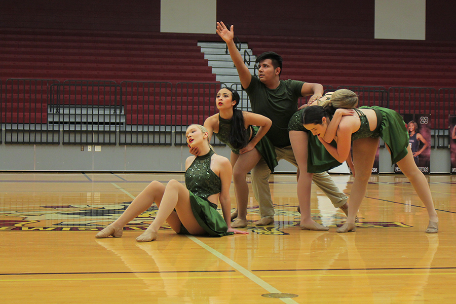 Farmerette senior captain Taylor Dill and senior and junior lieutenants pose closely together at the end of varsity officers contemporary.