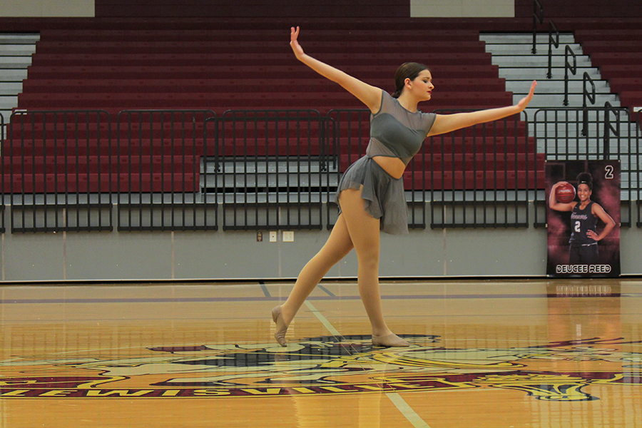 Performing her contest solo, sophomore Brantley Ibañez glides along the floor.