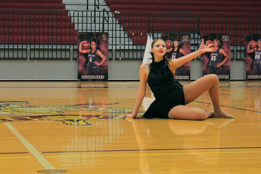 Sophomore Liberty Briscoe reaches out during her contest solo.