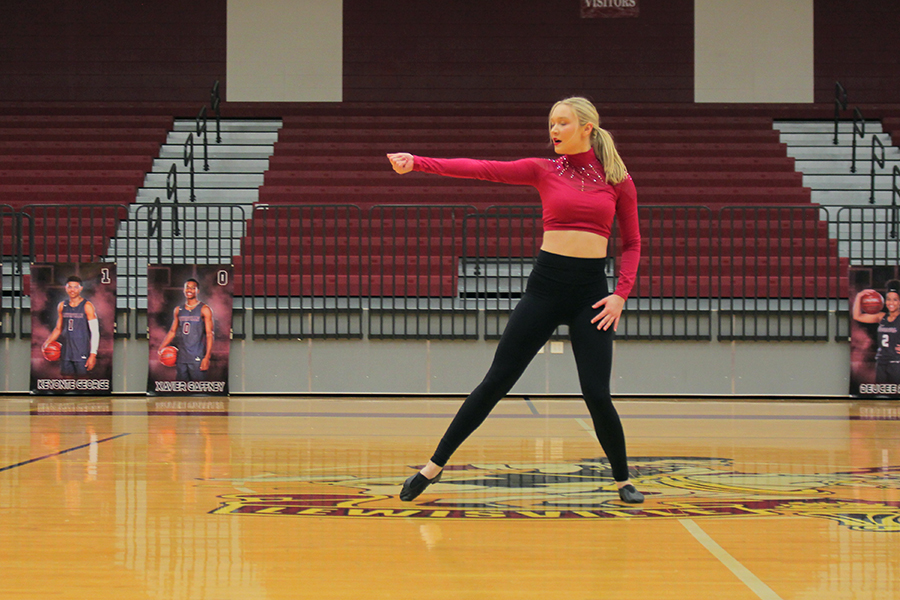 Snapping to the crowd, senior lieutenant Alexa Wolff dances during her contest solo.