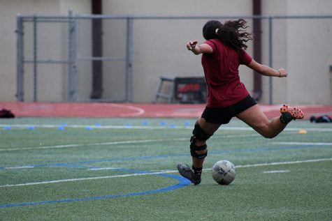 Senior forward Krisalin Salgado (22) swings her leg to shoot the ball at the goal during third period practice on Thursday, Jan. 9.