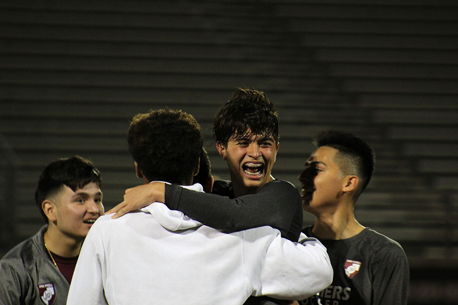 Senior captain Ethan Carbajal (21) celebrates the 1-0 win against Hebron on Tuesday, March 10.