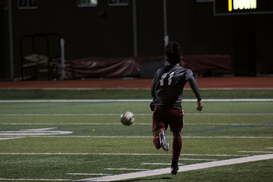 Junior Tony Cantoran (11) chases after the ball.