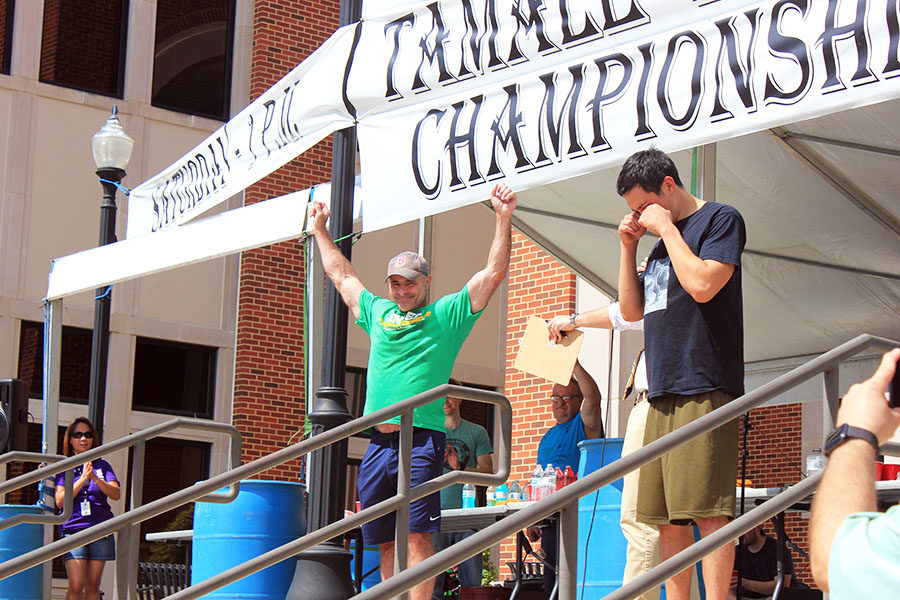 Geoffrey Esper celebrates as he is announced winner of Tamale Eating World Championship.
