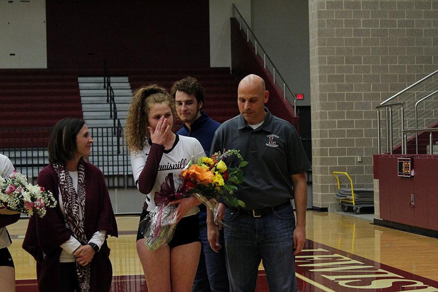 Senior Emerson Coburn holds back tears as her name is called for senior night.