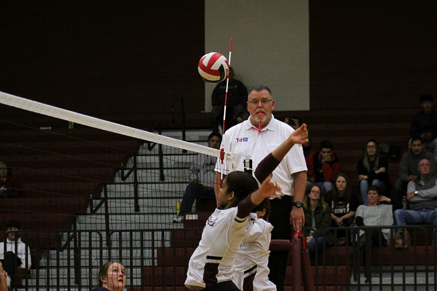 Senior Micaela Godinez jumps to block the ball after the other team hit it over the net.