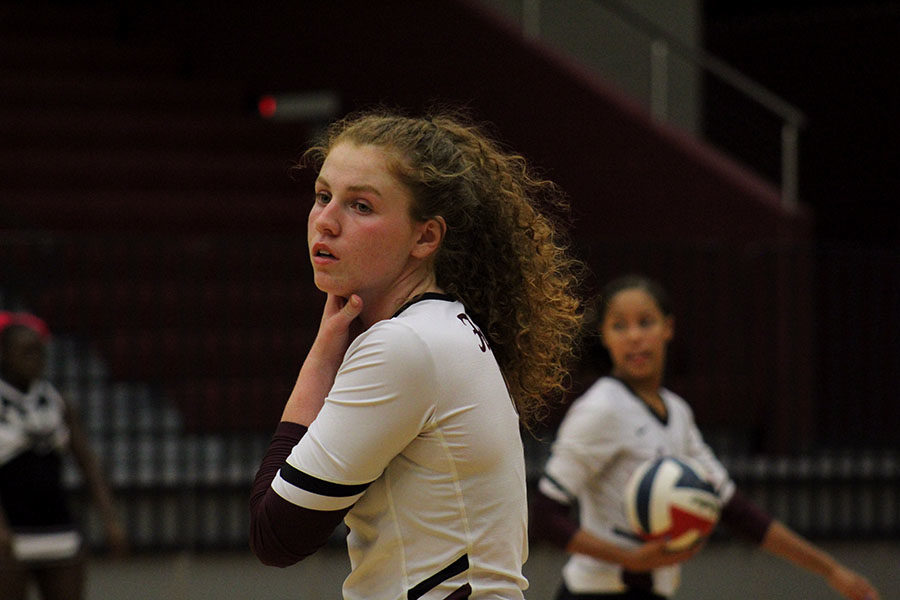 Senior Emerson Coburn catches her breath between plays.