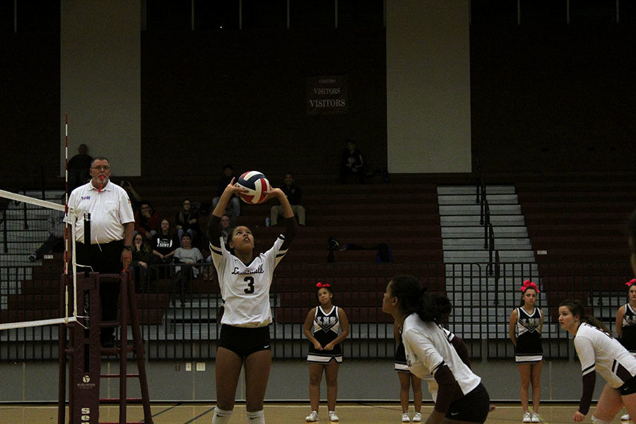 Sophomore Mataiya Perry sets the ball for freshman Mya Black to spike it over the net.