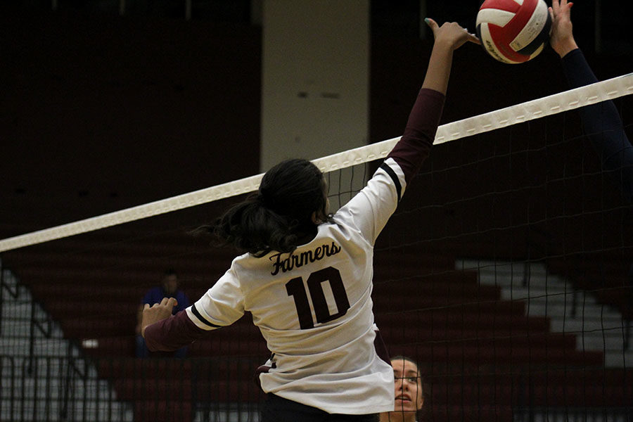 Freshman Mya Black blocks a spike made by a Nimitz player.