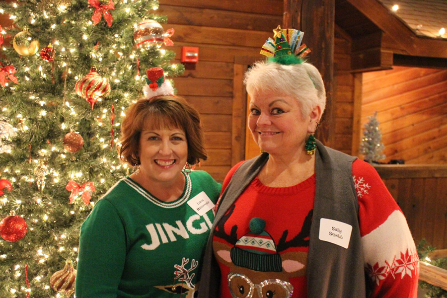 Speech+and+debate+teachers+Liana+Massengale+and+Sally+Squibb+attend+the+2018+staff+Christmas+party.+Courtesy+of+Liana+Massengale.