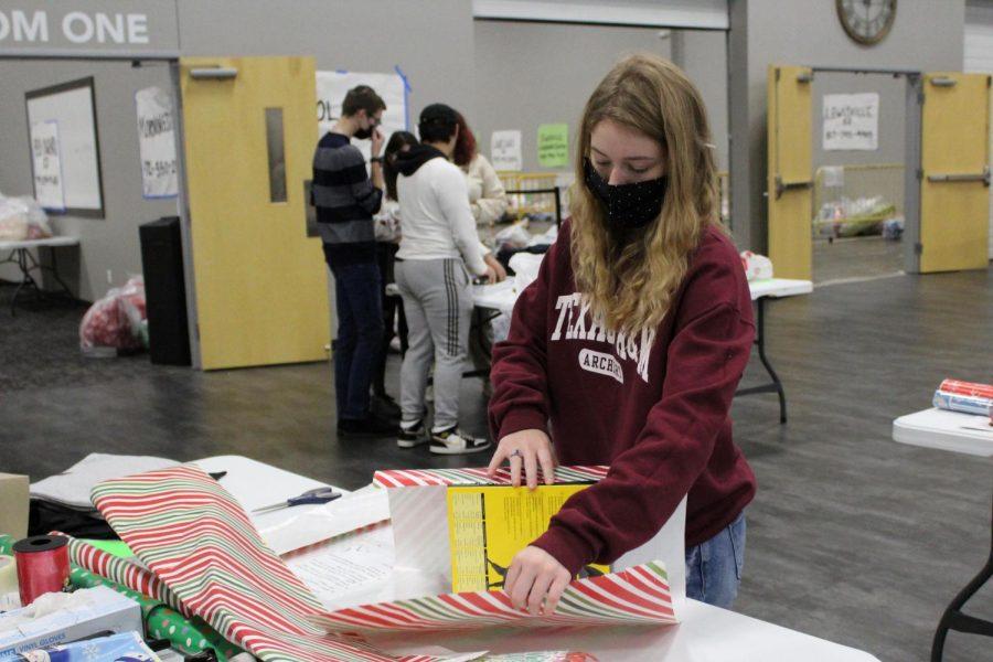 Senior Emily McGee wraps a gift for LISD's Adopt an Angel program.