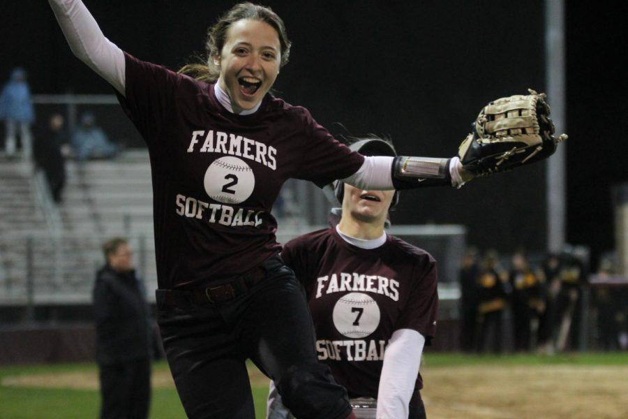 Madeline Brooks smiles during a softball game.