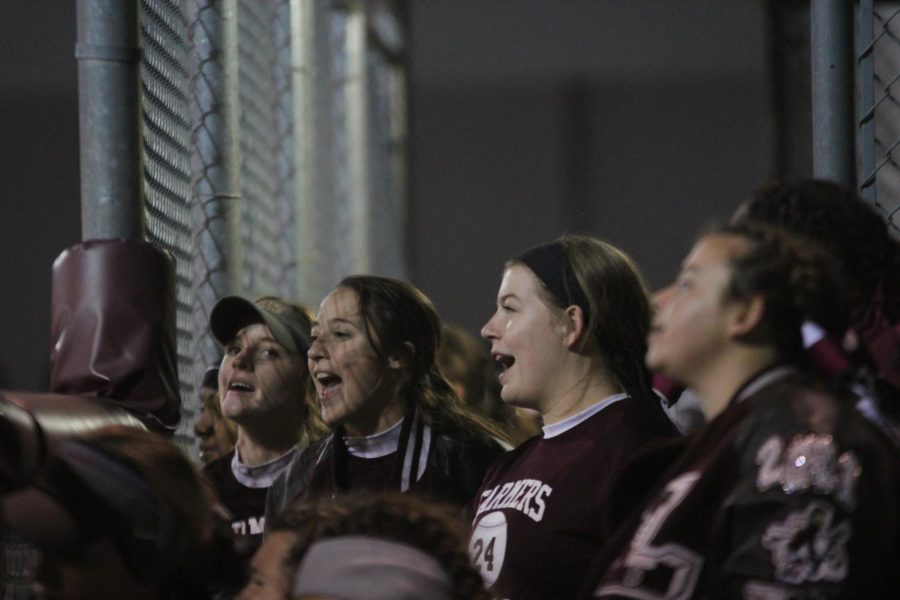 Madeline cheers on her fellow teammates during one of last year's softball games.