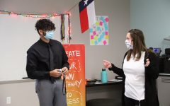 Senior Akash Chinta talks with INCubator teacher Valerie Cooper about his business to the board of advisers on Tuesday, Feb. 2.