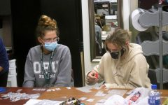 Seniors Erin Bonehill and Kayla Miller create sashes for senior superlatives to wear to prom-VID.