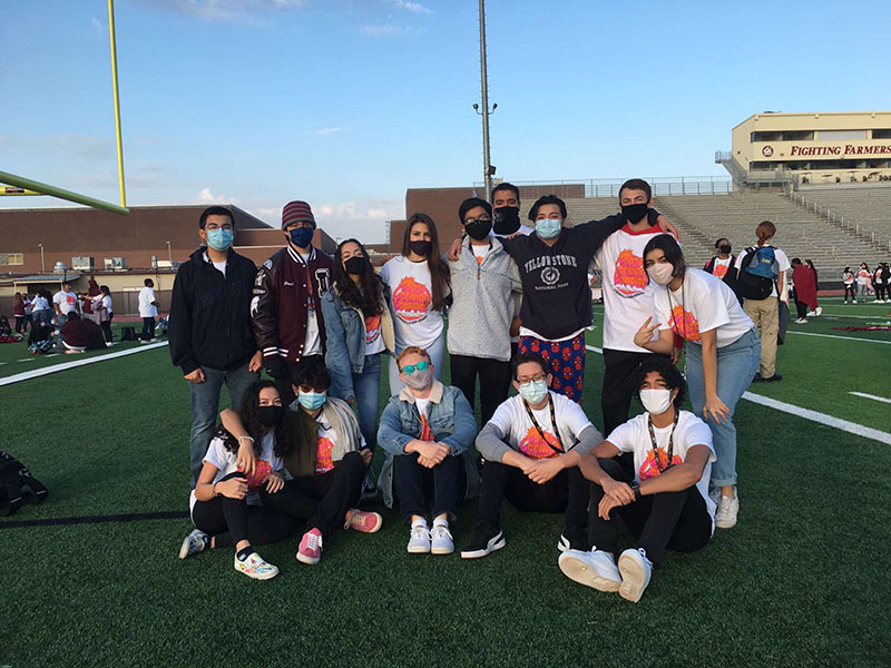 Senior Paul McCulley takes a picture with friends during senior sunrise. Photo courtesy of Paul McCulley.